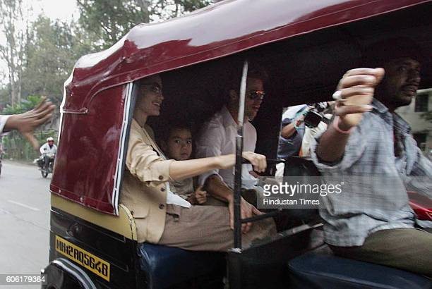 Brangelina Hollywood actors Brad Pitt Angelina Jolie and son Maddox take an autorickshaw ride in Pune on Sunday