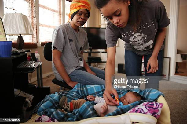 Brania Jackson gives a pacifier to her son Jordy, who in November was born without eyes, a rare condition called anophthalmia, as Jackson's mother...