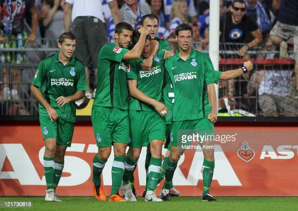 Branimir Bajic of Duisburg jubilates with team mates after scoring the second goal during the Second Bundesliga match between FC St. Pauli and MSV...