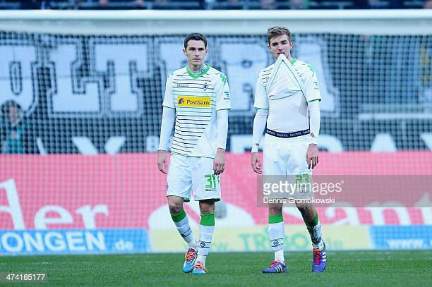 Branimir Hrgota and Christoph Kramer of Borussia Moenchengladbach look dejected after the Bundesliga match between Borussia Moenchengladbach and 1899...
