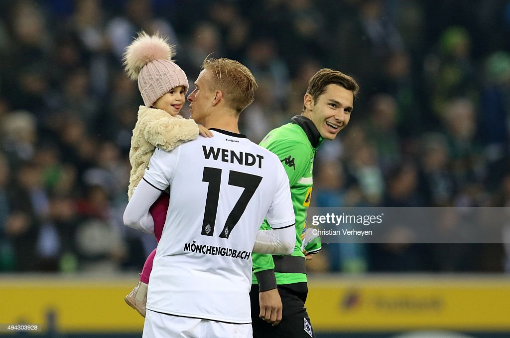 Branimir Hrgota and Oscar Wendt with his daughter of Borussia Moenchengladbach after the Bundesliga match between Borussia Moenchengladbach and FC Schalke 04 at Borussia-Park on October 25, 2015 in Moenchengladbach, Germany