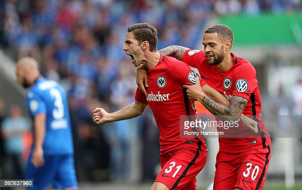 Branimir Hrgota celebrates after scoring his team's opening goal with Luc Castaignos during the DFB Cup match between 1 FC Magdeburg and Eintracht...