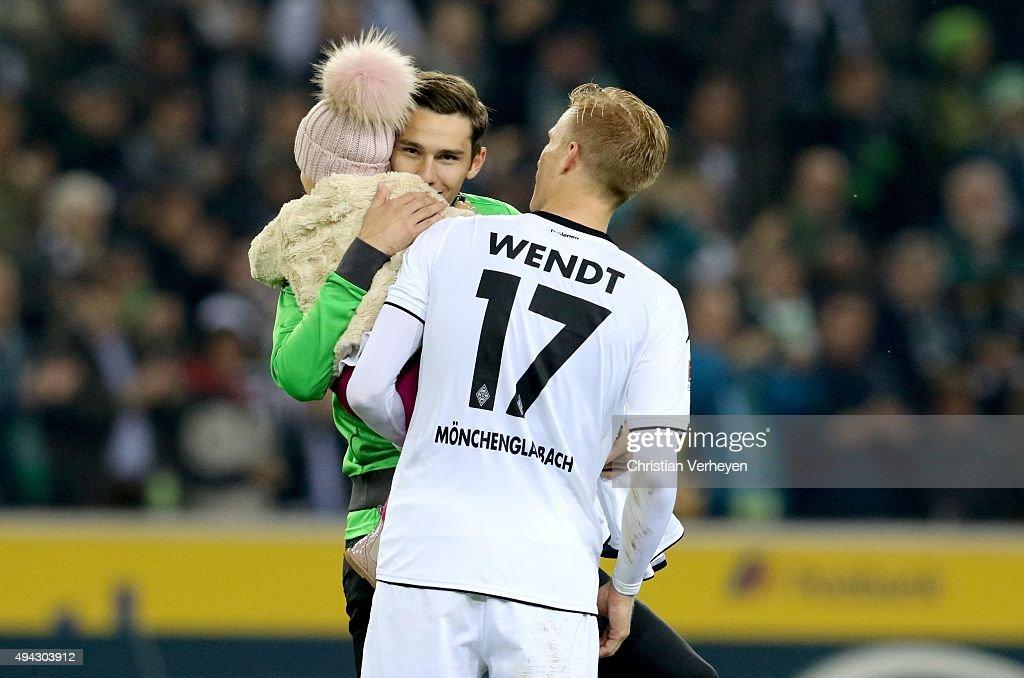 Branimir Hrgota hugs the daughter of Oscar Wendt of Borussia Moenchengladbach after the Bundesliga match between Borussia Moenchengladbach and FC Schalke 04 at Borussia-Park on October 25, 2015 in Moenchengladbach, Germany