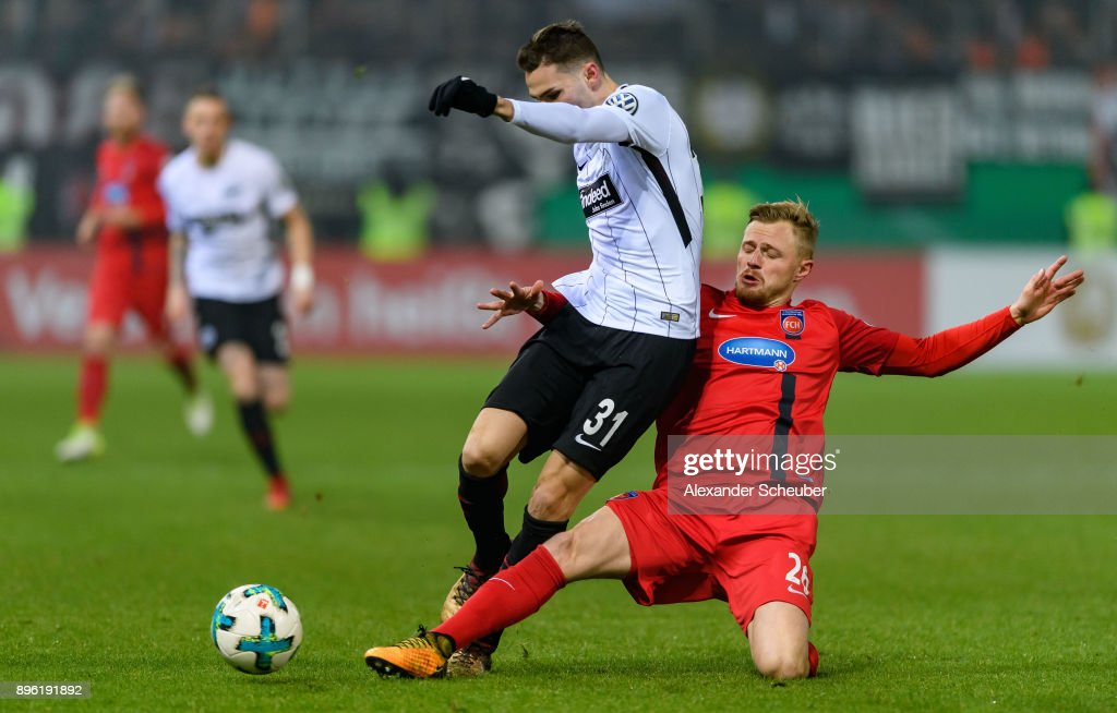 Branimir Hrgota of Eintracht Frankfurt in action against Marcel Titsch-Rivero of Heidenheim during the DFB Cup match between 1. FC Heidenheim and Eintracht Frankfurt at Voith-Arena on December 20, 2017 in Heidenheim, Germany.