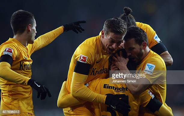 Branimir Hrgota of Frankfurt celebrates with team mates after scoring his team's first goal during the Bundesliga match between FC Augsburg and...