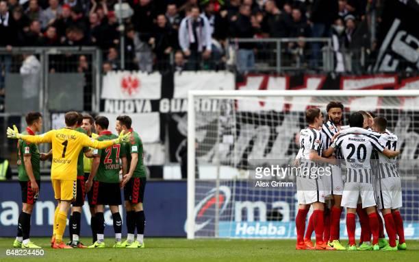 Branimir Hrgota of Frankfurt celebrates with team mates after scoring his teams first goal during the Bundesliga match between Eintracht Frankfurt...