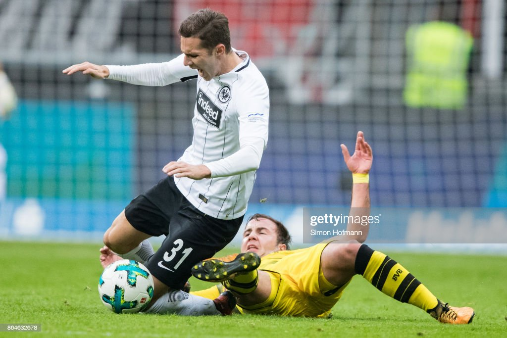 Branimir Hrgota of Frankfurt is fouled by Mario Goetze of Dortmund during the Bundesliga match between Eintracht Frankfurt and Borussia Dortmund at Commerzbank-Arena on October 21, 2017 in Frankfurt am Main, Germany.