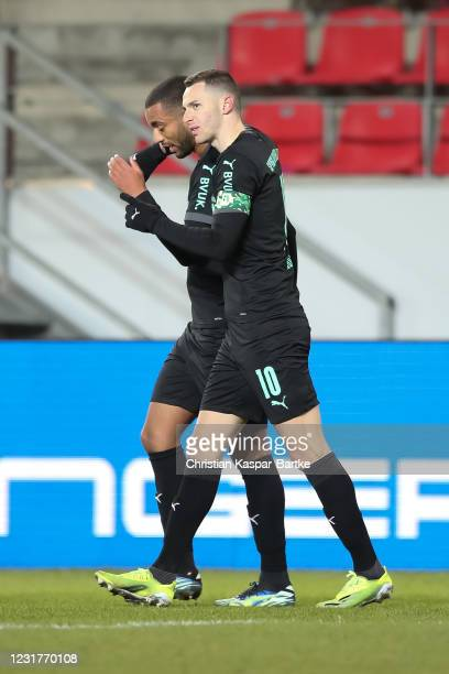Branimir Hrgota of SpVgg Greuther Fuerth celebrates after scoring his team`s first goal with teammate Timothy Tillmann of SpVgg Greuther Fuerth...