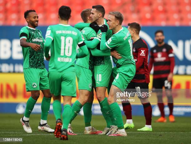 Branimir Hrgota of SpVgg Greuther Fuerth is congratulatred by Harvard Nielsen of SpVgg Greuther Fuerth after scoring the third goal during the Second...