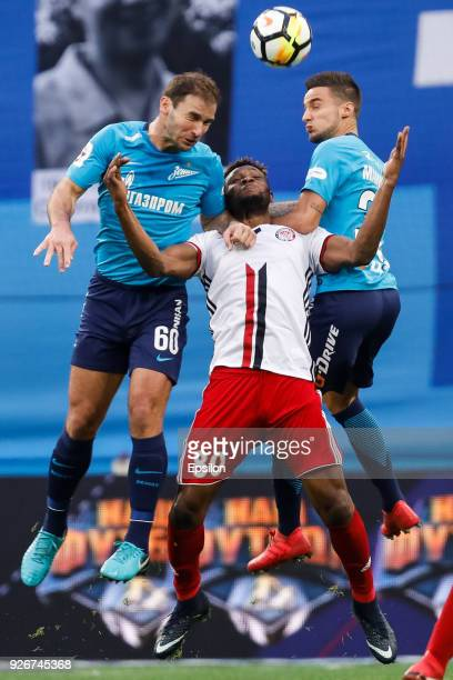 Branislav Ivanovic and Emanuel Mammana of FC Zenit Saint Petersburg vie for the ball with Aaron Olanare of FC Amkar Perm during the Russian Football...