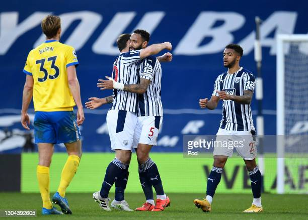 Branislav Ivanovic and Kyle Bartley of West Bromwich Albion celebrate following their team's victory in the Premier League match between West...