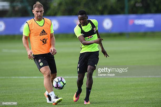 Branislav Ivanovic Baba Rahman during a Chelsea training session at Chelsea Training Ground on July 12 2016 in Cobham England