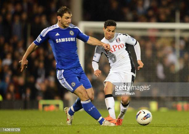 Branislav Ivanovic of Chelsea and Kerim Frei of Fulham compete for the ball during the Barclays Premier League match between Fulham and Chelsea at...