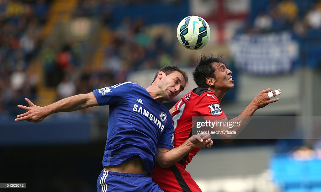 Branislav Ivanovic (L) of Chelsea and Leonardo Ulloa of Leicester challenge in a heading duel during the Barclays Premier League match between Chelsea and Leicester City at Stamford Bridge on August 23, 2014 in London, England.