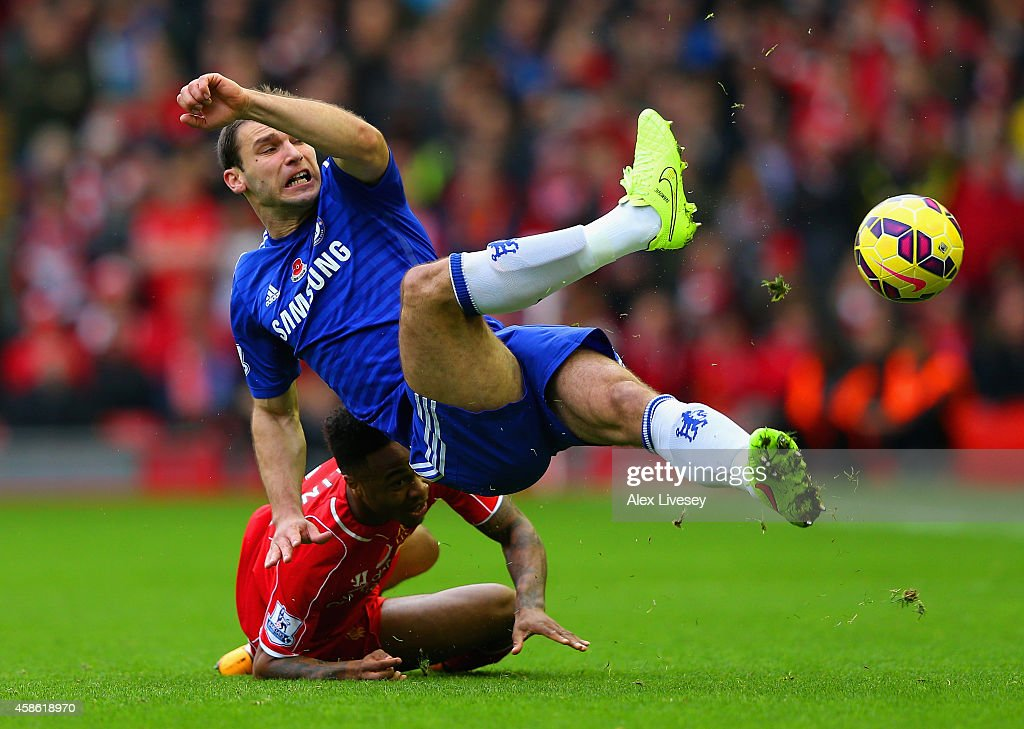 Branislav Ivanovic of Chelsea and Raheem Sterling of Liverpool battle for the ball during the Barclays Premier League match between Liverpool and Chelsea at Anfield on November 8, 2014 in Liverpool, England.