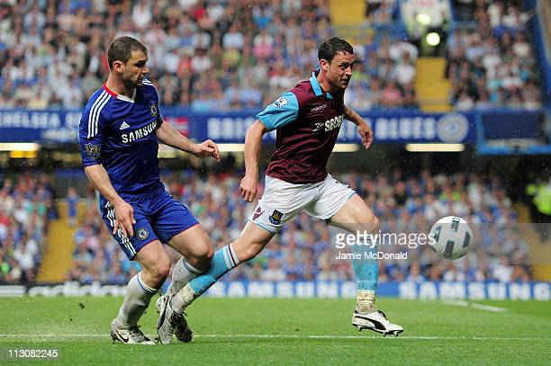 Branislav Ivanovic of Chelsea and Wayne Bridge of West Ham compete for the ball during the Barclays Premier League match between Chelsea and West Ham...