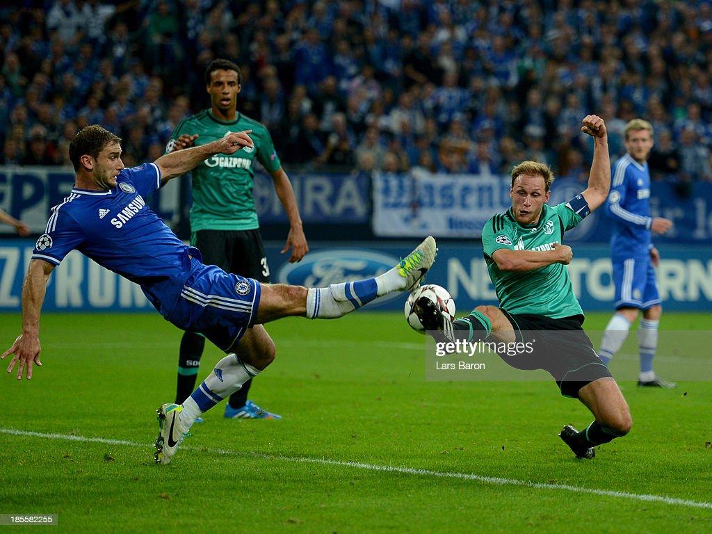 Branislav Ivanovic of Chelsea battles with Benedikt Howedes of Schalke 04 during the UEFA Champions League Group E match between FC Schalke 04 and Chelsea at Veltins-Arena on October 22, 2013 in Gelsenkirchen, Germany.