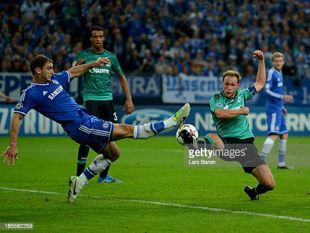Branislav Ivanovic of Chelsea battles with Benedikt Howedes of Schalke 04 during the UEFA Champions League Group E match between FC Schalke 04 and...