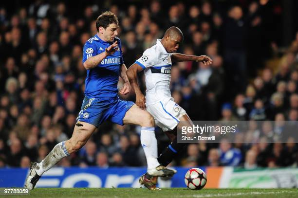 Branislav Ivanovic of Chelsea cannot catch Samuel Eto'o of Inter Milan as he scores the opening goal during the UEFA Champions League round of 16...