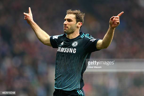 Branislav Ivanovic of Chelsea celebrates after scoring his team's second goal during the Barclays Premier League match between Aston Villa and...