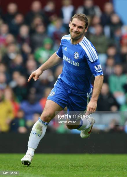 Branislav Ivanovic of Chelsea celebrates his second goal during the Barclays Premier League match between Aston Villa and Chelsea at Villa Park on...