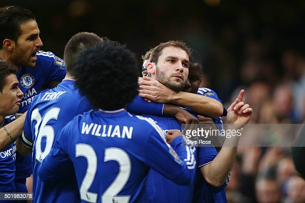 Branislav Ivanovic of Chelsea celebrates scoring his team's first goal with his team matesduring the Barclays Premier League match between Chelsea...