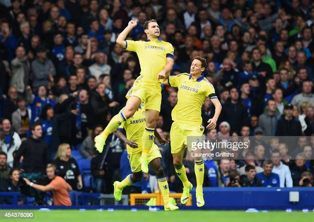 Branislav Ivanovic of Chelsea celebrates scoring his team's second goal with team mate Nemanja Matic during the Barclays Premier League match between...