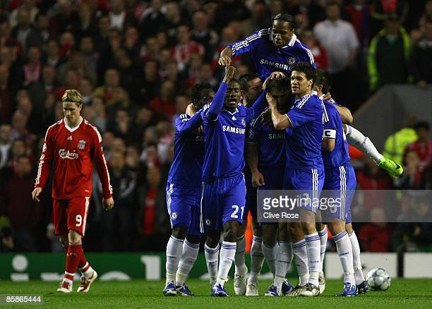 Branislav Ivanovic of Chelsea celebrates with his team mates after scoring his team's first goal during the UEFA Champions League Quarter Final First...