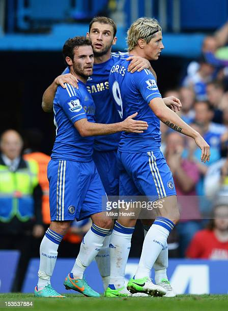 Branislav Ivanovic of Chelsea celebrates with Juan Mata and Fernando Torres as he scores their fourth goal during the Barclays Premier League match...