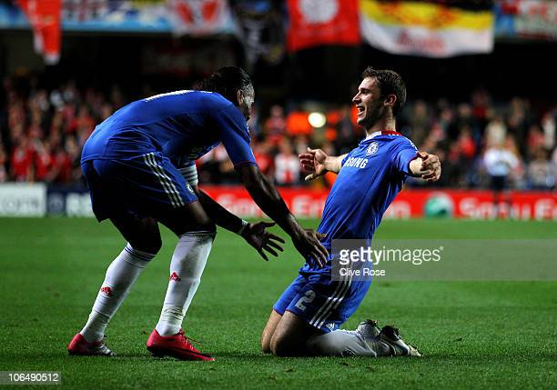 Branislav Ivanovic of Chelsea celebrates with teammate Didier Drogba after scoring his team's third goal during the UEFA Champions League group F...
