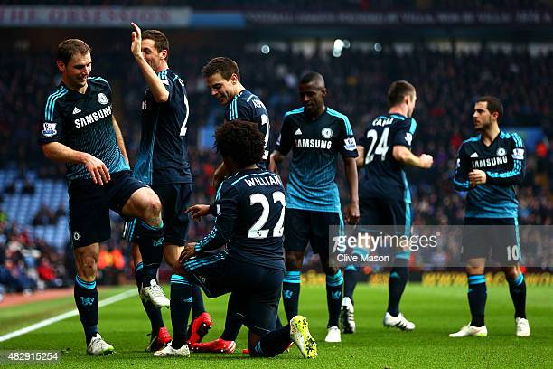 Branislav Ivanovic of Chelsea celebrates with teammates after scoring his team's second goal during the Barclays Premier League match between Aston...