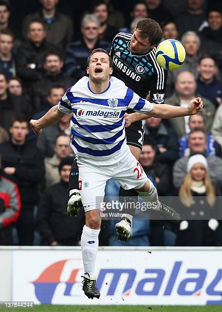 Branislav Ivanovic of Chelsea challenges for a header with Heidar Helguson of Queens Park Rangers during the FA Cup with Budweiser Fourth Round match...