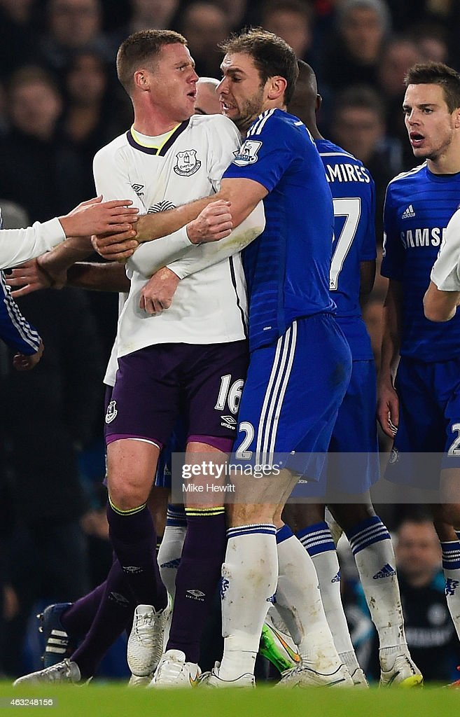 Branislav Ivanovic of Chelsea clashes with James McCarthy of Everton during the Barclays Premier League match between Chelsea and Everton at Stamford Bridge on February 11, 2015 in London, England.