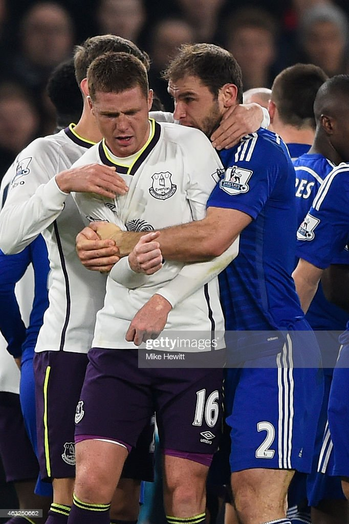 Branislav Ivanovic of Chelsea grabs James McCarthy of Everton during the Barclays Premier League match between Chelsea and Everton at Stamford Bridge on February 11, 2015 in London, England.