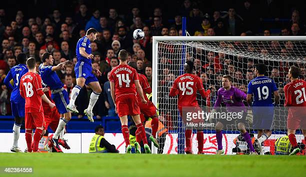 Branislav Ivanovic of Chelsea heads in their first goal in extra time during the Capital One Cup SemiFinal second leg between Chelsea and Liverpool...