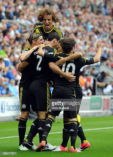 Branislav Ivanovic of Chelsea is congratulated by his teammates after scoring the opening goal during the Barclays Premier League match between Wigan...