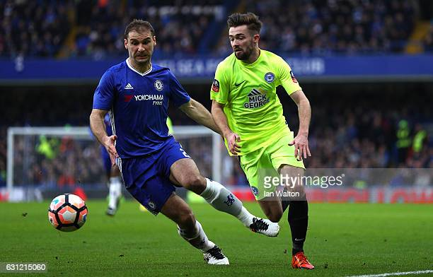 Branislav Ivanovic of Chelsea is put under pressure from Gwion Edwards of Peterborough United during The Emirates FA Cup Third Round match between...