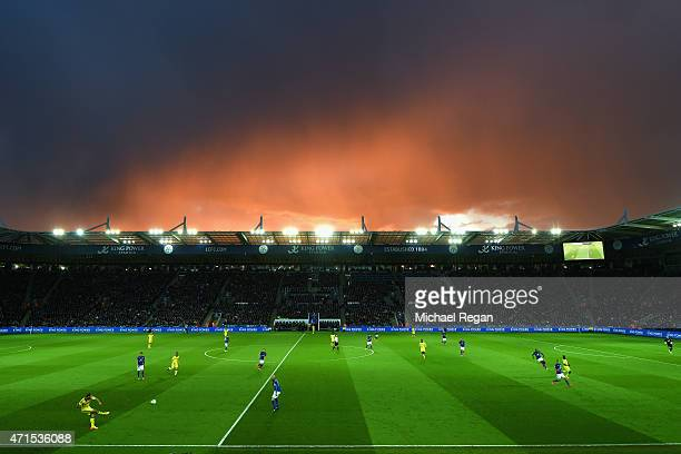 Branislav Ivanovic of Chelsea kicks the ball up field as stormy skies are seen over the King Power Stadium during the Barclays Premier League match...