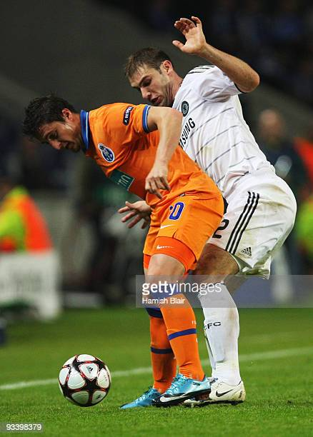 Branislav Ivanovic of Chelsea marshalls Cristian Rodriguez of FC Porto during the UEFA Champions League Group D match between FC Porto and Chelsea at...