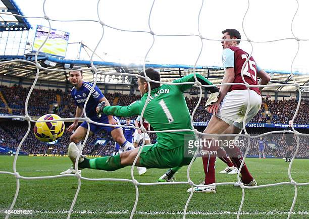 Branislav Ivanovic of Chelsea scores the opening goal past goalkeeper Thomas Heaton of Burnley during the Barclays Premier League match between...