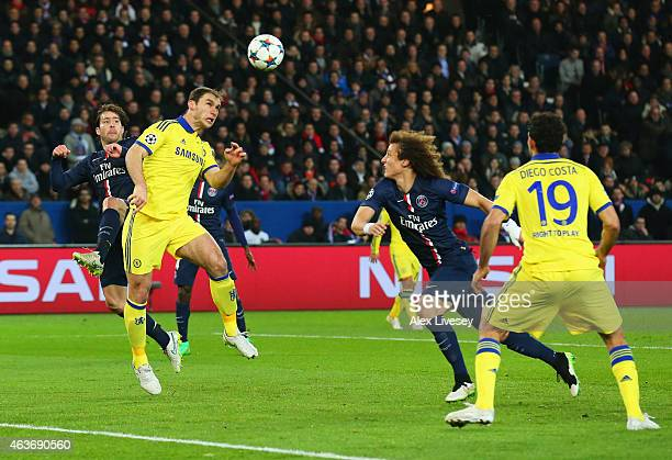 Branislav Ivanovic of Chelsea scores their first goal with a header during the UEFA Champions League Round of 16 match between Paris SaintGermain and...