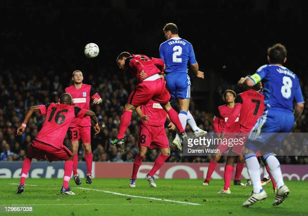 Branislav Ivanovic of Chelsea scores their fourth goal with a header during the UEFA Champions League group E match between Chelsea and Genk at...