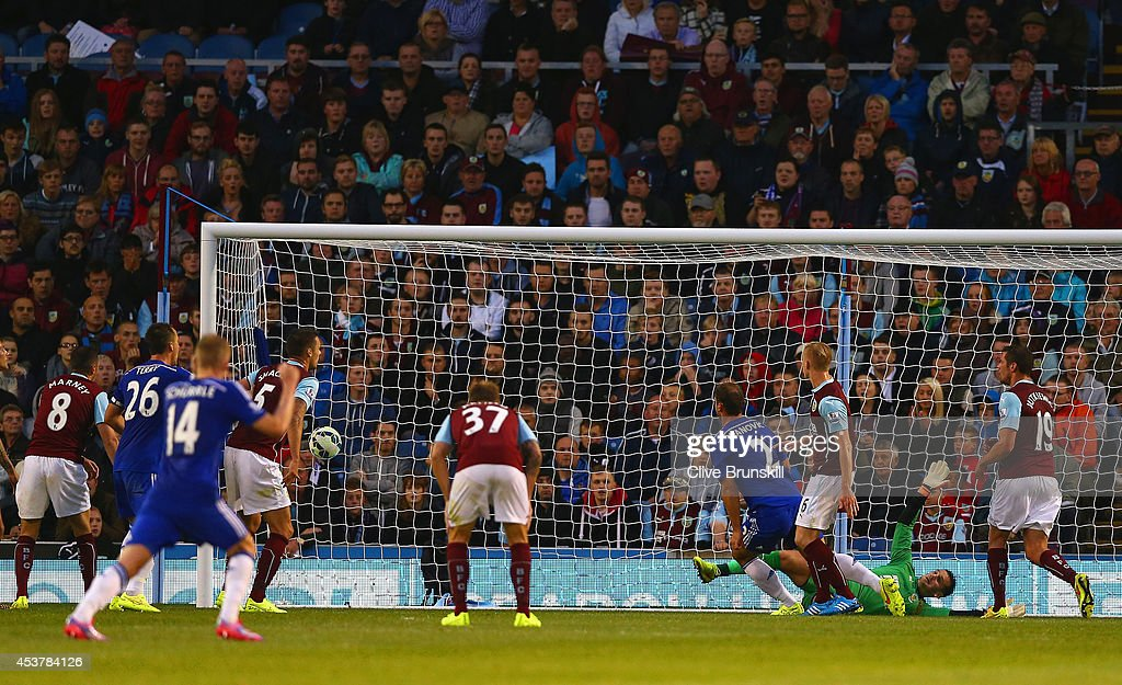 Branislav Ivanovic of Chelsea scores their third goal past Thomas Heaton of Burnley during the Barclays Premier League match between Burnley and Chelsea at Turf Moor on August 18, 2014 in Burnley, England.