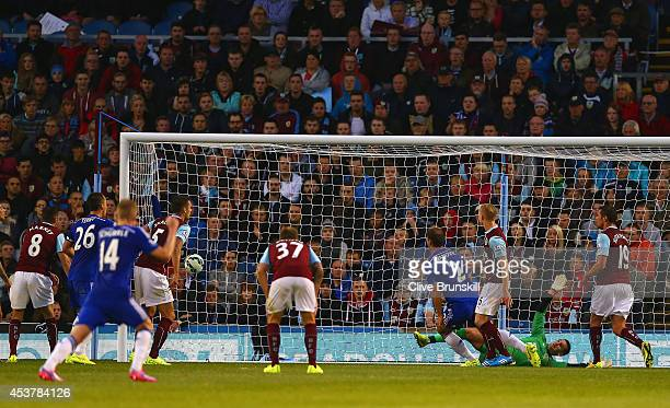 Branislav Ivanovic of Chelsea scores their third goal past Thomas Heaton of Burnley during the Barclays Premier League match between Burnley and...