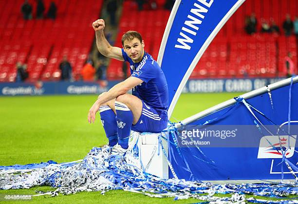 Branislav Ivanovic of Chelsea sits on the winners podium after the Capital One Cup Final match between Chelsea and Tottenham Hotspur at Wembley...