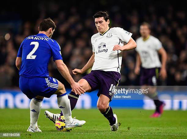 Branislav Ivanovic of Chelsea tackles Gareth Barry of Everton during the Barclays Premier League match between Chelsea and Everton at Stamford Bridge...