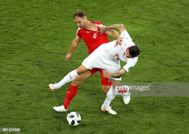 Branislav Ivanovic of Serbia battles for possession with Steven Zuber of Switzerland during the 2018 FIFA World Cup Russia group E match between...