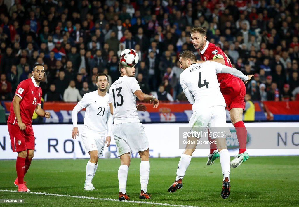Branislav Ivanovic (R) of Serbia in action against Guram Kashia (L) of Georgia during the FIFA 2018 World Cup Qualifier between Serbia and Georgia at stadium Rajko Mitic on October 9, 2017 in Belgrade.