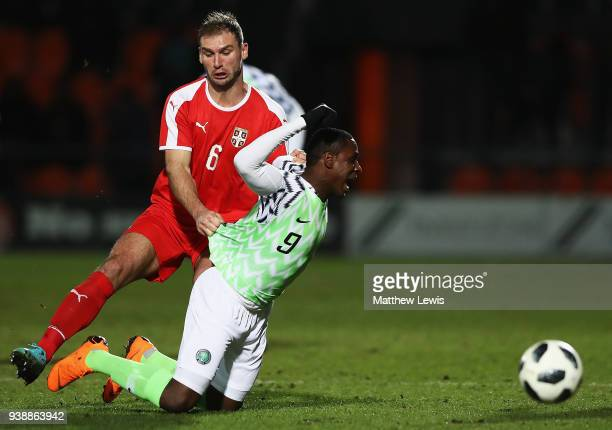 Branislav Ivanovic of Serbia tackles Odion Ighalo of Nigeria during the International Friendly match between Nigeria and Serbia at The Hive on March...