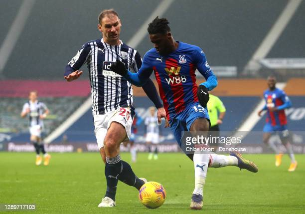 Branislav Ivanovic of West Bromwich Albion and Jeffrey Schlupp of Crystal Palace in action during the Premier League match between West Bromwich...